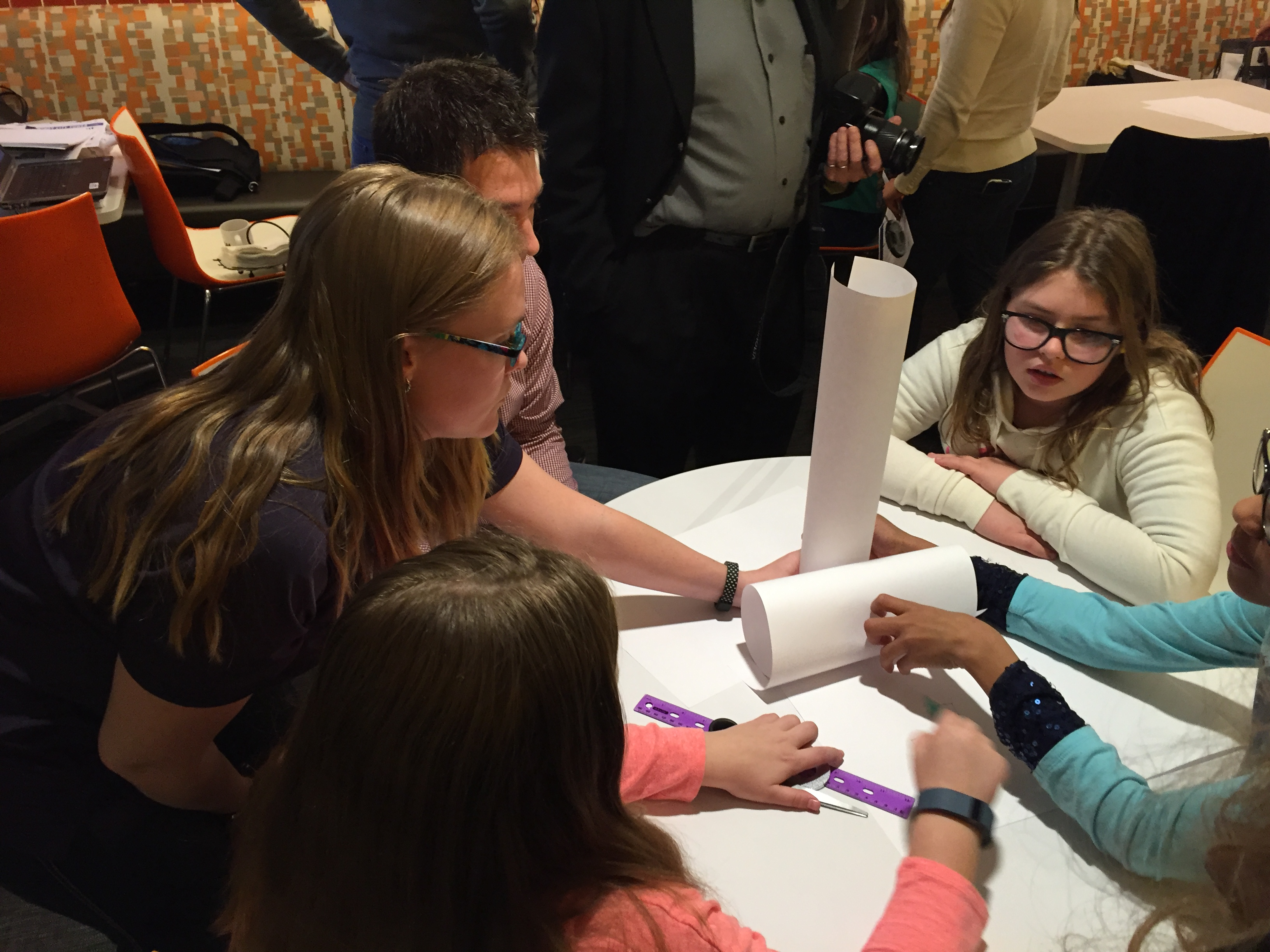 Girl Scouts work with engineers to design structures in the Windy City Tower activity.