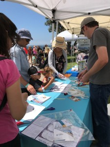 Street fair outreach event with both a STEAM activity booth and a promotional materials booth