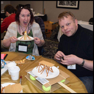 Kelsey Skrobis (left) of Anchorage Public Library and Tor Anderzen (right), a member of the Mat‐Su Branch of the American Society of Civil Engineers, team up for some fun STEAM learning!