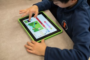 A second grader works on their Scratch Jr. project.