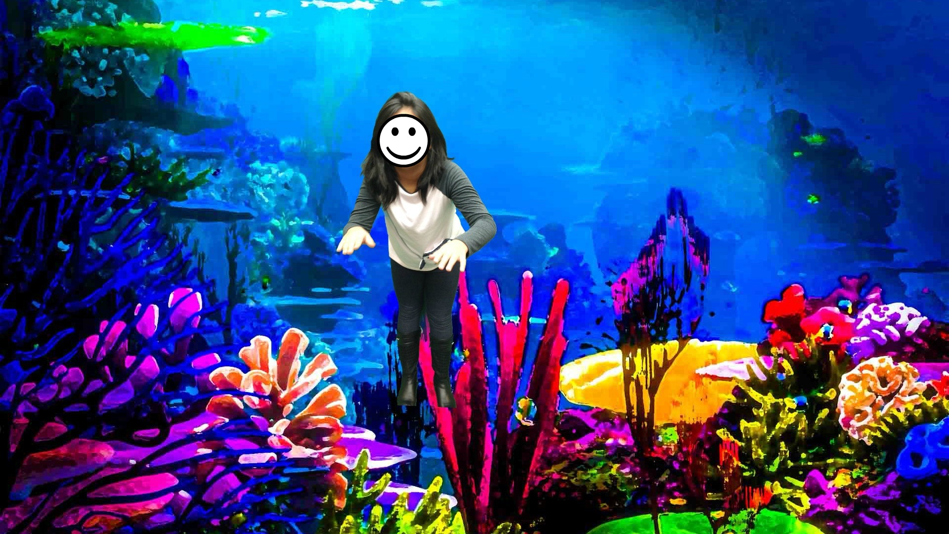 Child placed underwater using green screen app. Face covered for privacy.