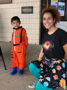 """An aspiring astronaut visits with Miriam """"Aunty Mimi"""" Fuchs, telescope system specialist at the East Asian Observatory, after Aunty Mimi's Spectacular Science Show."""
