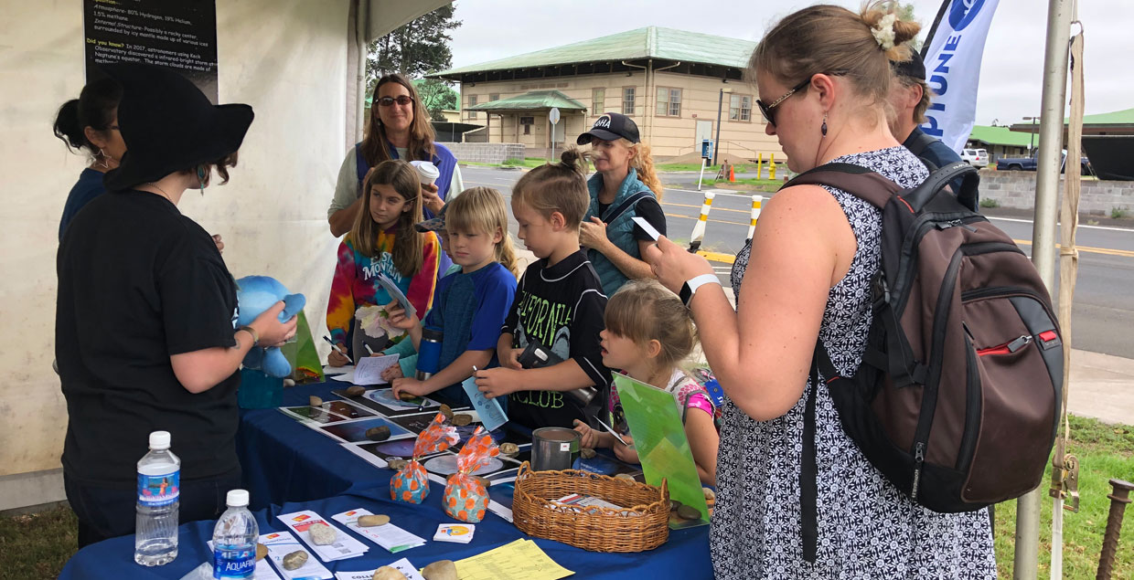 Families learn about Neptune during the Waimea Solar Walk, hosted by the Maunakea Observatories.